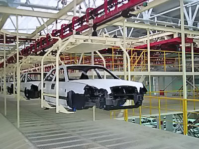 Power & Free conveyor system for transport of vehicle bodies