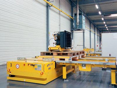 Automated floor transport vehicle BTSif used to transport compressors