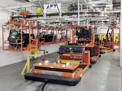Automated floor transport vehicle BTS used to supply components at assembly lines