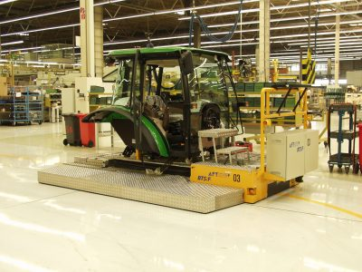 Automated floor transport vehicle BTSif used in assembly line for tractors